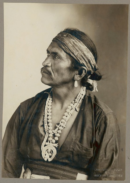 Chief Kia-E-Te-Nita in Native Dress with Squash Blossom Necklace and Silver Concha Belt - 1908