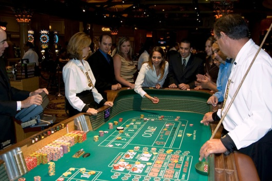 Craps table in Las Vegas, Nevada, Caesars Palace and Casino, gaming, gambling, craps, craps players, throwing dice, die, model released, craps table, NV, Las Vegas, Photo nv224-17956. Copyright: Lee Foster, www.fostertravel.com, 510-549-2202,lee@fostertravel.com